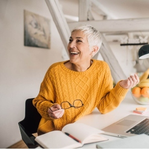 older woman working in yellow jumper